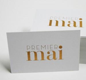 <span>PREMIER MAI</span><i>→</i>